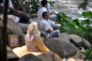 Yogiraj meditating with disciples at the Upper Sacramento River by Mt. Shasta.